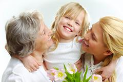 Portrait of happy girl hugging mature lady and woman Stock Photos