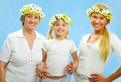 portrait of grandmother, mother and child looking at camera with smiles - stock photo