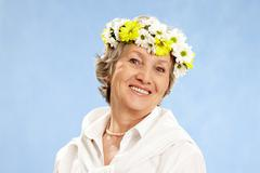 Portrait of mature woman with diadem on her head Stock Photos
