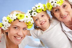 Portrait of grandmother with adult daughter and grandchild with diadems Stock Photos