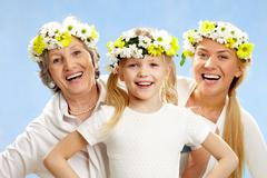 Stock Photo of portrait of grandmother and mother behind smiling girl