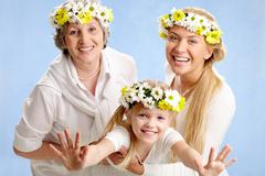 image of grandmother and mother holding child on their hands - stock photo