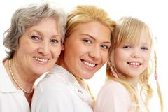 conceptual image of old lady, young woman and girl - stock photo