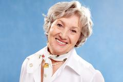 portrait of stylish woman grey haired looking at camera - stock photo