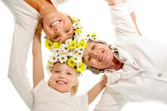 image of female relatives embracing each other with their heads in center - stock photo