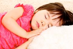 close-up of lovely little girl sleeping - stock photo