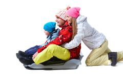 portrait of happy family tobogganing on white background - stock photo