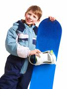 portrait of happy boy with skateboard on white background - stock photo