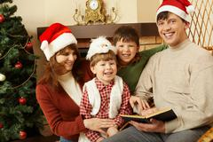 portrait of happy family members standing next to each other and laughing while - stock photo