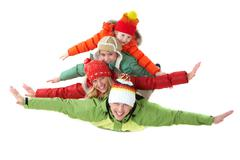 happy family members looking at camera with smiles and their arms stretched - stock photo