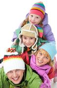 heap of happy family members looking at camera with smiles - stock photo