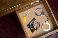 Desk drawer of a law enforcement officer Stock Photos