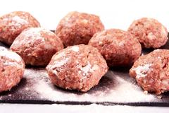 Image of several raw cutlets meat with flour Stock Photos