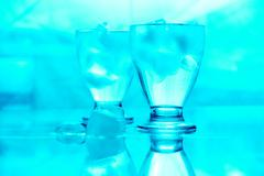 blue image of two glasses of water with ice - stock photo