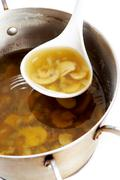 Photo of fungoid soup in pan and ladle Stock Photos