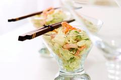 Image of vegetable salad in crystal glassware served with chopsticks Stock Photos