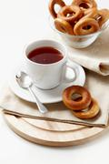 Photo of brunch of cup of tea with sweet bread-rings Stock Photos
