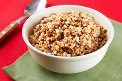 dinner image of bowl of buckwheat kasha during dinner - stock photo