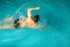 photo of sportsman swimming during competition - stock photo