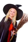Portrait of girl in witch costume looking at camera Stock Photos