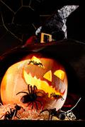 Image of halloween pumpkin in hat with spiders on it Stock Photos