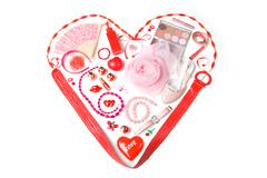 Image of heart made up of lady cosmetics and accessories Stock Photos