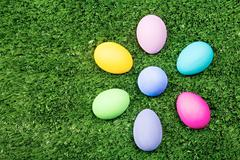 Photo of colored eggs on grassland viewed from above Stock Photos