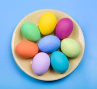 image of several color eggs placed on plate - stock photo