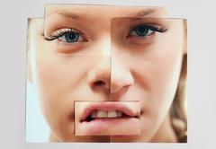 face of young girl made up of cut images - stock photo