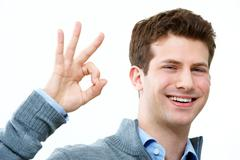 handsome man showing sign of okay and smiling - stock photo