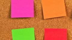 Pieces of note paper on a cork bulletin board Stock Footage