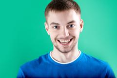 Stock Photo of portrait of young man looking at camera with smile
