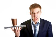 portrait of young dissatisfied businessman shouting in isolation - stock photo
