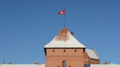 Trakai castle towers snow flag horse rider ichneumon blue sky Stock Footage