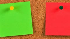 pieces of note paper on a cork bulletin board - stock footage