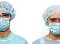 Two surgeons in masks isolated on white Stock Photos
