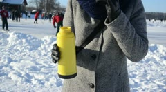 Woman glove pour hot tea coffee thermos drink winter sport skate Stock Footage