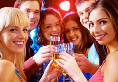 portrait of joyful people celebrating birthday - stock photo