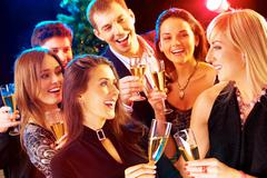 photo of joyful people relaxing together at party - stock photo