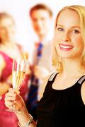portrait of beautiful lady with champagne on the background of people - stock photo