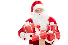 photo of happy santa claus with red giftboxes in hands - stock photo