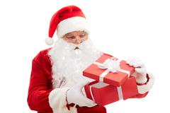 photo of happy santa claus looking into red giftbox in isolation - stock photo