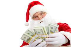 Photo of happy santa claus with dollar bills looking at camera Stock Photos