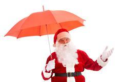 photo of happy santa claus with red umbrella in isolation - stock photo