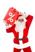 Photo of happy santa claus with red package full of giftboxes Stock Photos