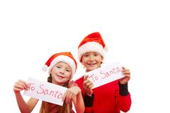 happy children holding small papers with note 'to santa' - stock photo