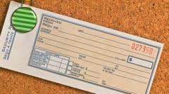 Blank receipt hanging on a cork bulletin board Stock Footage