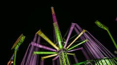 Stock Video Footage of Time Lapse view of a colorful fun fair attraction at night