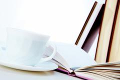 Image of open notepad with ballpoint and cup of coffee near by Stock Photos