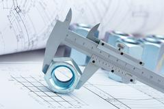 Close-up of architectural ruler holding screw-thread Stock Photos